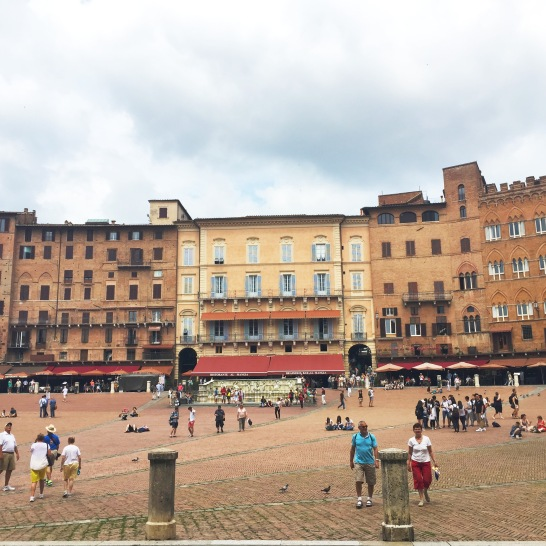Siena's Piazza Del Campo. Once a year they have horse races around this tilted piazza that dates since the medieval time.